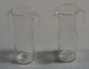 Pair of glass creamers or childs coffee pot