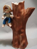 Enesco hillbilly boy in tree
