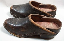 Wooden bottom Shoes with leather uppers