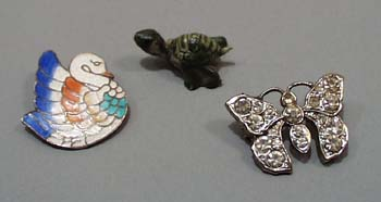 3 PC pins and turtle.