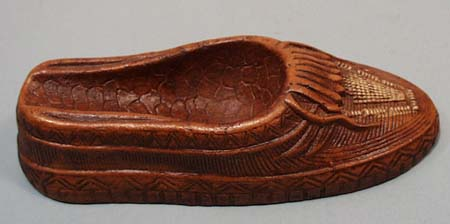 Redwood moccasin pipe holder