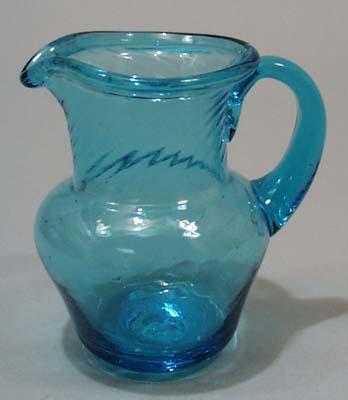 Hand blown mini pitcher with turned lip