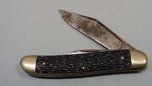 Pocket knife.  Brass metal