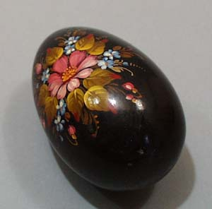 Wooden tole painted Egg.