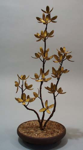 Bovaro of Chestshire Maine yellow flowers tree statue