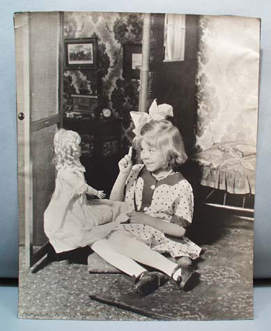 1910 photo girl talks to doll