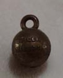 Old plastic basketball charm that says Purdue Boilermakers
