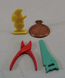 4 plastic cracker jack toys?