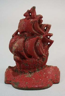Old red ship bookend,