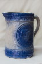 Blue and White Pitcher displaying cows