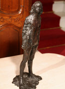 BRONZE SCULPTURE OF A WOMAN STANDING