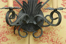 A PAIR OF IRON PAINTED TWO LIGHT SCONCES