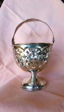 Sterling silver Ornate urn shaped pierced serving piece with handle