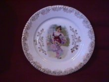 Porcelain Display Plate of Victorian Lady Gathering Yellow & Pink Roses
