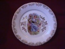Porcelain Display Plate Featuring Lady In Tree With Basket of Pink Flowers