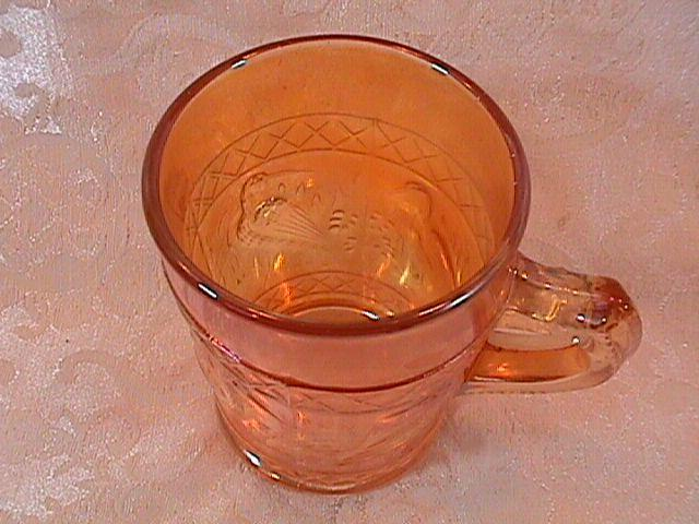 CARNIVAL GLASS STORK and RUSHES MUG MARIGOLD