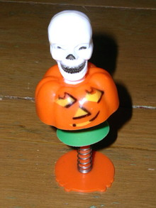 Halloween Pumpkin With Skull on Spring Stand