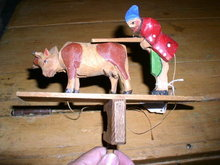 Handcarved Wood Man and Cow Toy