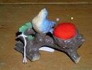 Celluloid Bird on Branch Pincushion