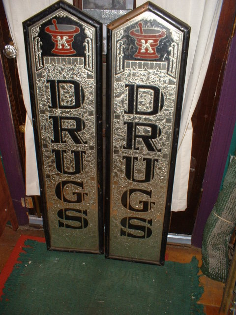 A Pair of Vintage Reverse Painted Drug Store Signs