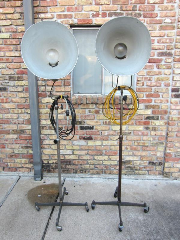 VERY RARE! PAIR OF VINTAGE PHOTOGENIC MACHINE CO. INDUSTRIAL MACHINE AGE STEAM PUNK MID-CENTURY MODERN ADJUSTABLE FLOOR LAMPS FLOODLIGHTS MODEL LIGHT ON IRON WHEEL BASE CASTERS