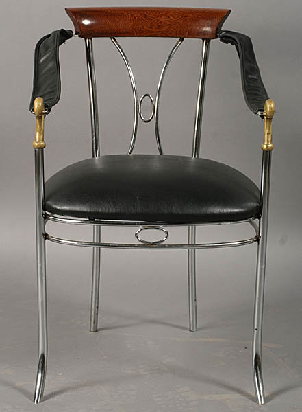 7401 Set of four chrome and bronze chairs, each having swan decorated arms and upholstered seats circa 1920.