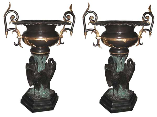 70.2606 Pair of Large Bronze Urns with Three Herons at Base
