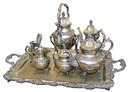 83.5859 Large Victorian 7 pc. Silverplate Tea Set with Detailed Grape Pattern