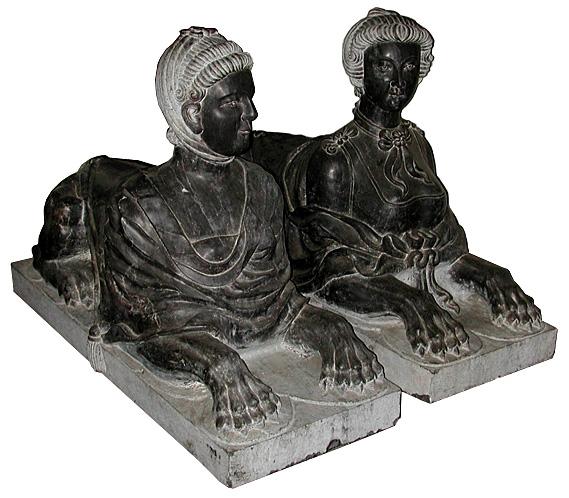 68.5867 Pair of Black Marble Sphinxes.