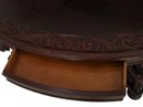 Carved top mahogany griffen oval table