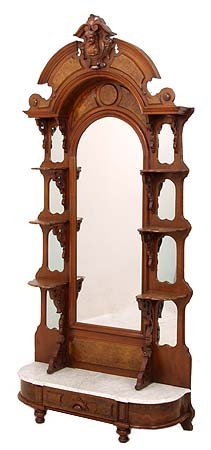Walnut Victorian etagere with carved head