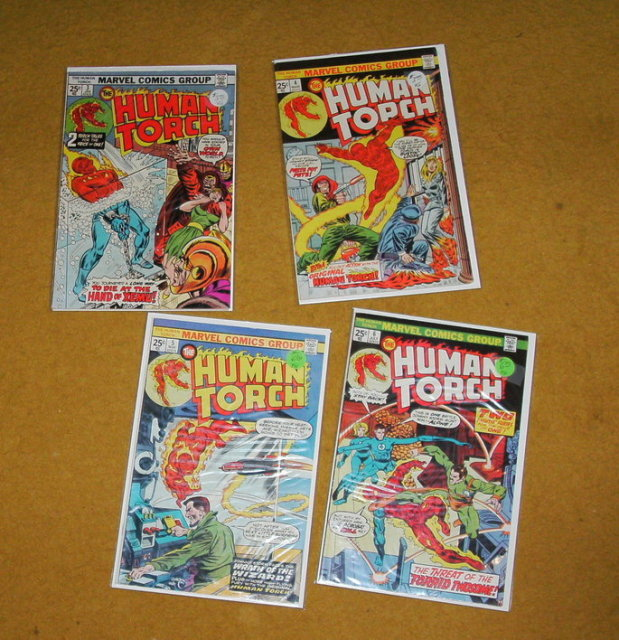 Four Human Torch comic books mostly fine