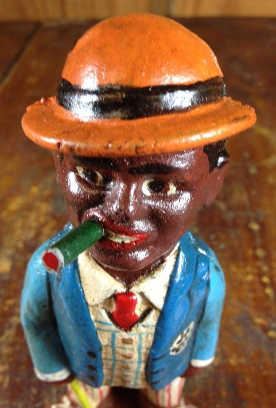 BLACK AMERICANA CAST IRON COIN BANK MAN IN NICE SUIT SMOKING CIGARETTE OR CIGAR
