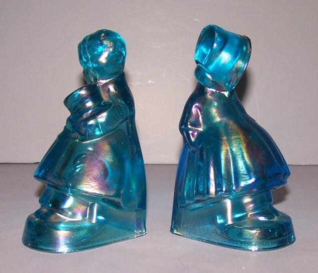 Iridescent Blue Bookends of a boy and Girl