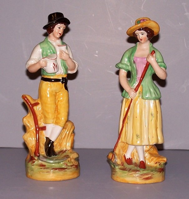 Pair of Boy and Girl Staffordshire Figurines