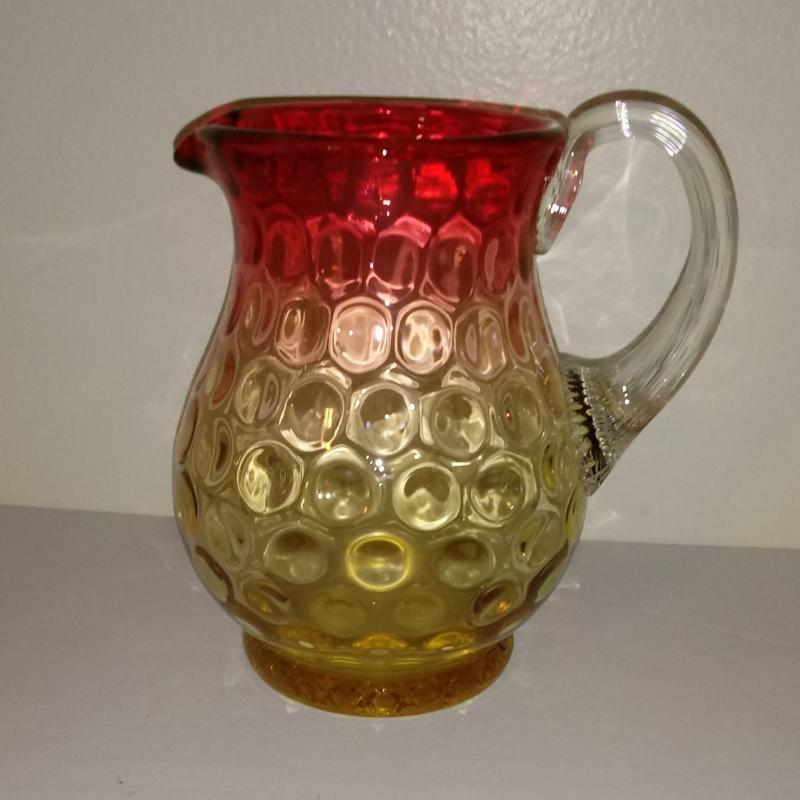 Amberina Coinspot Cream Pitcher with an applied reeded handle. 4 5/8 inches high.