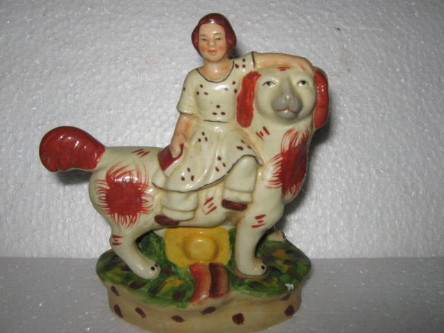 Porcelain Man riding Dog