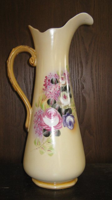 Tall Pale yellow pitcher with roses