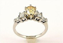 FANCY YELLOW DIAMOND RING,  1.80  CARATS  PEAR CUT  14k White Gold  Ring.  Open Reserve  $ 1790  * Certified