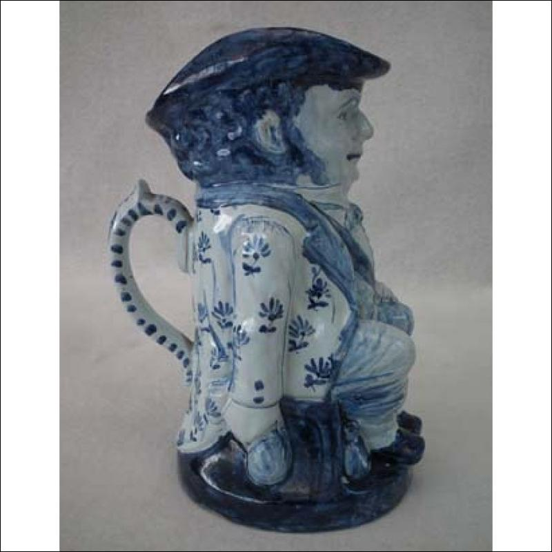 Antique Delft Blue and White Toby Jug 19th century .
