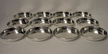 Carl Poul Petersen. Set of 12 Sterling coasters, Petersen, Montreal C.1960