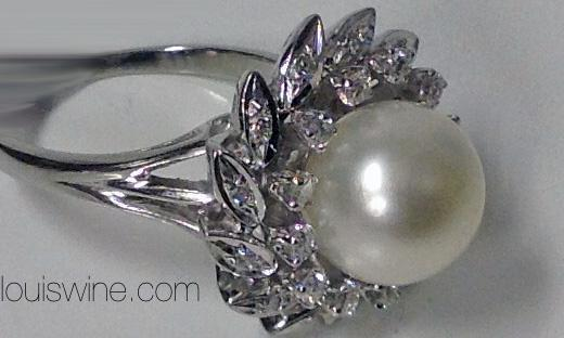 18K Pearl and Diamond cluster Ring.