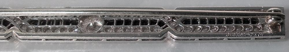 J. E. Caldwell Diamond, Onyx Platinum Bar Brooch, American, C.1930.