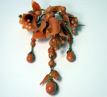 Large carved coral drop brooch, C.1850.