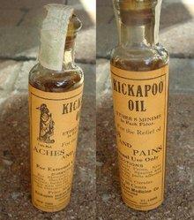 KICKAPOO OIL BOTTLE-UNOPENED; MEDICINAL;INDIAN IMAGE