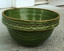 GREEN GLAZED OVER YELLOWWARE BOWL