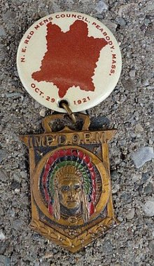 N.E. RED MEN'S COUNCIL CELLULOID PINBACK WITH WATCH FOB--INDIAN IMAGE & FISH