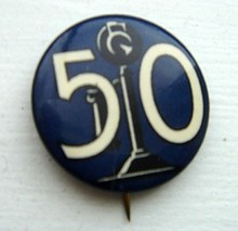 CELLULOID PINBACK BUTTON-IMAGE OF CANDLESTICK TELEPHONE & NO. 50