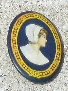 CELLULOID PINBACK OF WOMAN-WALTER BAKER COCOA WOMAN?