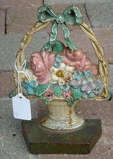 PAINTED CAST IRON  BASKET OF FLOWERS DOORSTOP